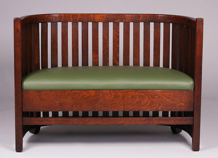 Plail Brothers Furniture Co Prairie School Barrel Back Settle C1905. Signed  With Paper Label. Excellent Original Finish. 33.5u2033h X 46u2033w X 20u2033d $4800